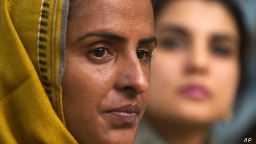 Pakistani gang rape victim Mukhtar Mai, left, addresses a news conference with lawmaker and Executive Director of Parliamentarian Human Rights Commission Kashmala Tariq in Islamabad, Pakistan on March 17, 2005.