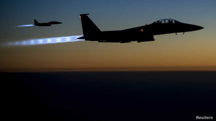 FILE - A pair of U.S. Air Force F-15E Strike Eagles fly over northern Iraq after conducting airstrikes in Syria, in this U.S. Air Force handout photo taken Sept. 23, 2014. These aircraft were part of a large coalition strike package that was the firs