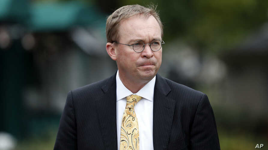 Director of the Office of Management and Budget Mick Mulvaney departs after a television interview at the White House, Sept. 13, 2017, in Washington.