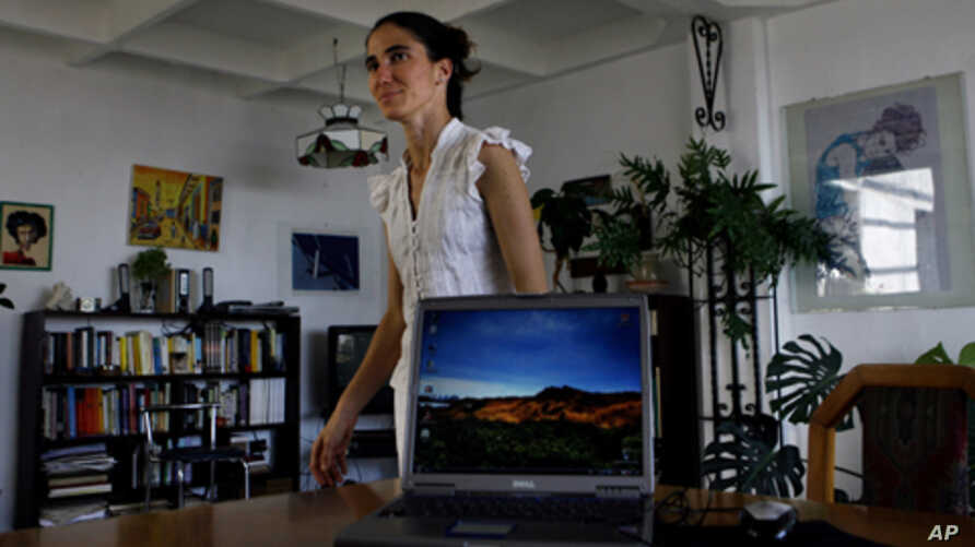 "Yoanis Sanchez, who writes the ""Generation Y"" blog, walks inside her home in Havana, Friday, April 11, 2008."