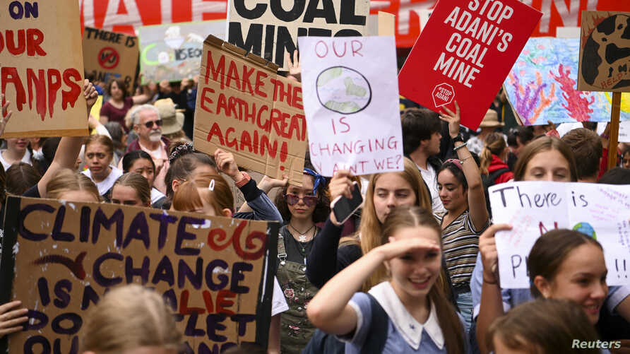"""Students are seen attending a """"Climate Strike"""" protest in Canberra, Australia, March 15, 2019."""