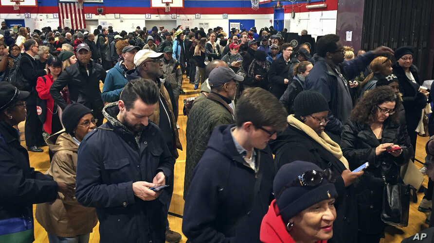Voters line up in crowds at a polling site to cast their ballots, Nov. 8, 2016, in the Flatbush section of Brooklyn in New York.
