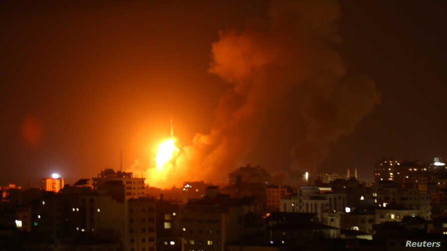 An explosion is seen during an Israeli air strike in Gaza City, Aug. 8, 2018.