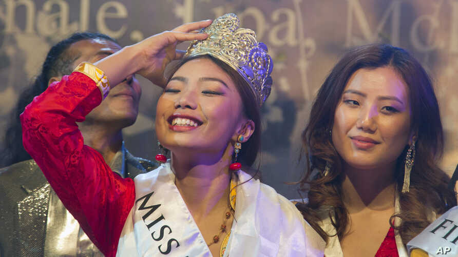 Tenzin Paldon, 21, reacts after winning the 2017 Miss Tibet beauty pageant at the Tibetan Institute of Performing Arts in Dharmsala, India, June 4, 2017.