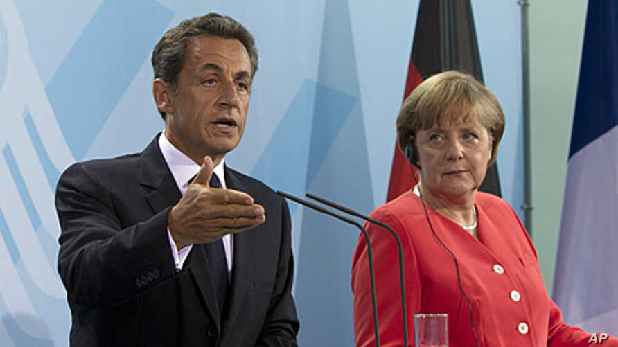 French President Nicolas Sarkozy and German Chancellor Angela Merkel brief the media at a news conference after their meeting at the chancellery in Berlin,  June 17, 2011