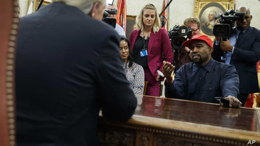 FILE - Rapper Kanye West speaks during a meeting in the Oval Office of the White House with President Donald Trump, in Washington, Oct. 11, 2018. It's one of Trump's favorite talking points in touting his administration's success: The record low rate