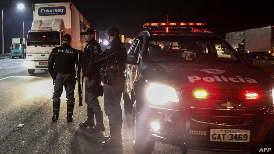 Members of the Brazil's military police and Sao Paulo's traffic police clear a blocked road in the city of Sao Bernardo do Campo, some 25 kilometers from Sao Paulo, Brazil, during the sixth day of a truckers' strike protesting rising fuel costs, May,