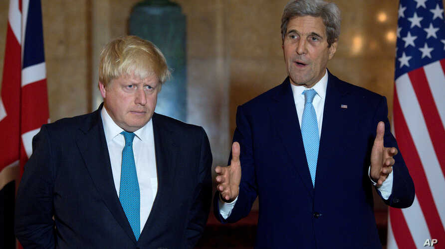 U.S. Secretary of State John Kerry (R) and British Foreign Secretary Boris Johnson give a joint press conference after a meeting on the situation in Syria at Lancaster House in London Oct. 16, 2016.