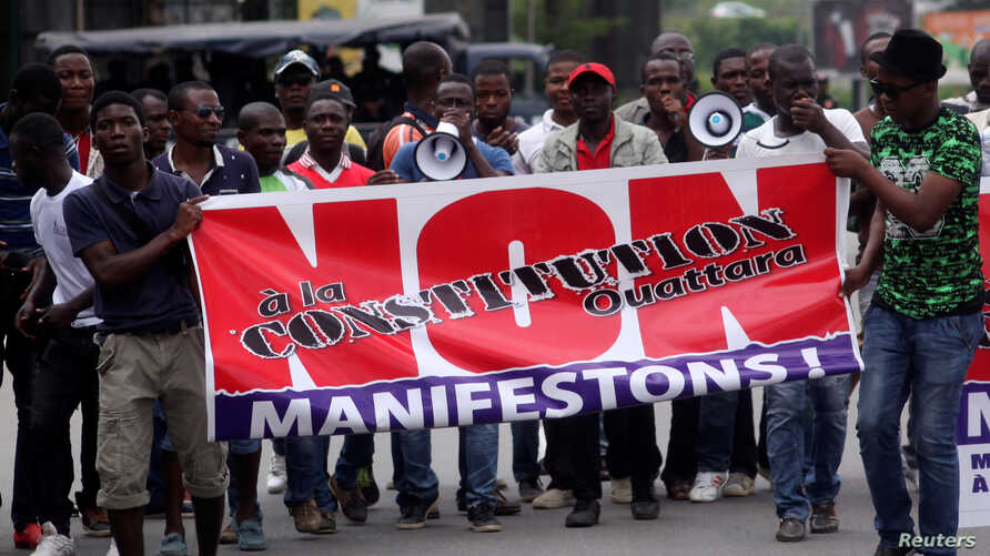 "Members and supporters of the Ivorian Popular Front (FPI) party protest against President Alassane Ouattara's new constitution, in Abidjan, Ivory Coast, Oct. 8, 2016. The banner reads, ""No to Ouattara constitution."""