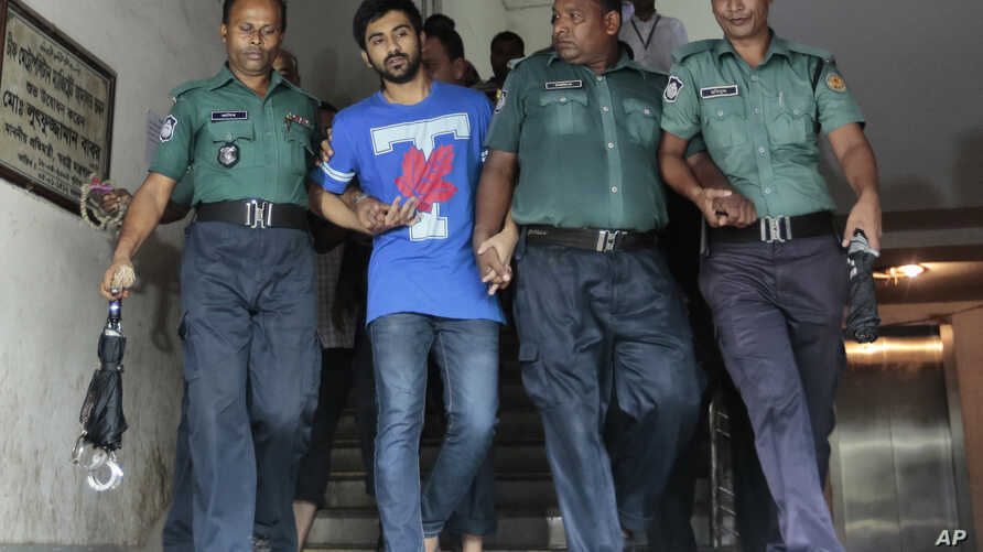 FILE - Bangladeshi policemen escort University of Toronto student Tahmid Hasib Khan, second left, after a court appearance in Dhaka, Bangladesh, Saturday, Aug.13, 2016.