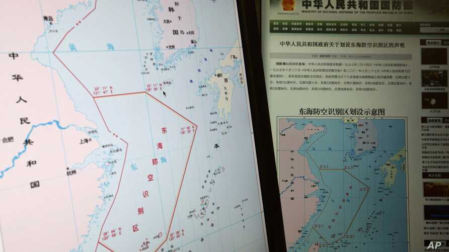 Computer screens display map showing outline of China's new air defense zone in the East China Sea, website of Chinese Ministry of Defense, Beijing, Nov. 26, 2013.
