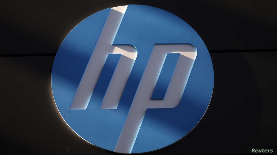 FILE - A Hewlett-Packard logo is seen at the company's Executive Briefing Center in Palo Alto, California.
