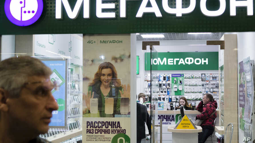 People inside a Megafon mobile phones shop in Moscow, Russia, May 13, 2017. A top Russian mobile operator said Friday it had come under cyberattacks that appeared similar to those that have crippled some U.K. hospitals