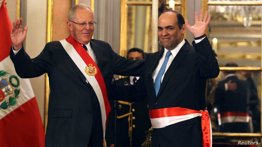 Peru's President Pedro Pablo Kuczynski (L) and new Economy Minister Fernando Zavala wave to the audience during the swearing-in ceremony at the government palace in Lima, Peru, June 23, 2017.