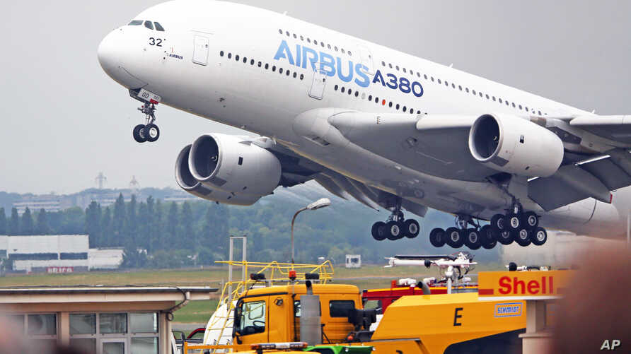 FILE - An Airbus A380 takes off for a demonstration flight at the Paris Air Show in Le Bourget, north of Paris, June 18, 2015.