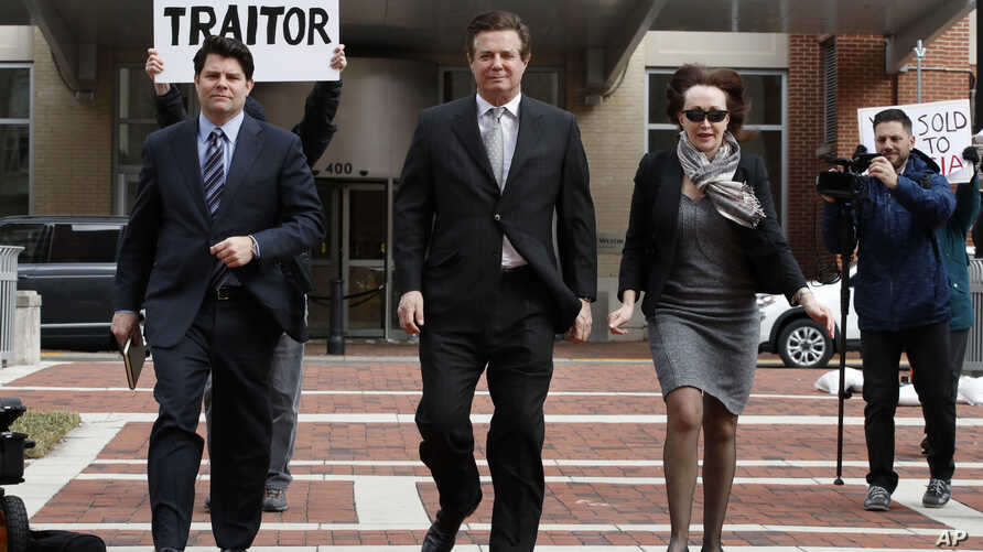 Paul Manafort, center, President Donald Trump's former campaign chairman, walks with this wife Kathleen Manafort, right, and  Jason Maloni, Manafort's spokesman, left, as they arrive at the Alexandria Federal Courthouse for an arraignment hearing on