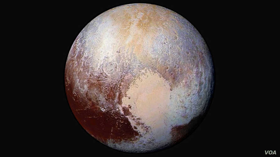 New Horizons scientists use enhanced color images to detect differences in the composition and texture of Pluto's surface, image released July 24, 2015.