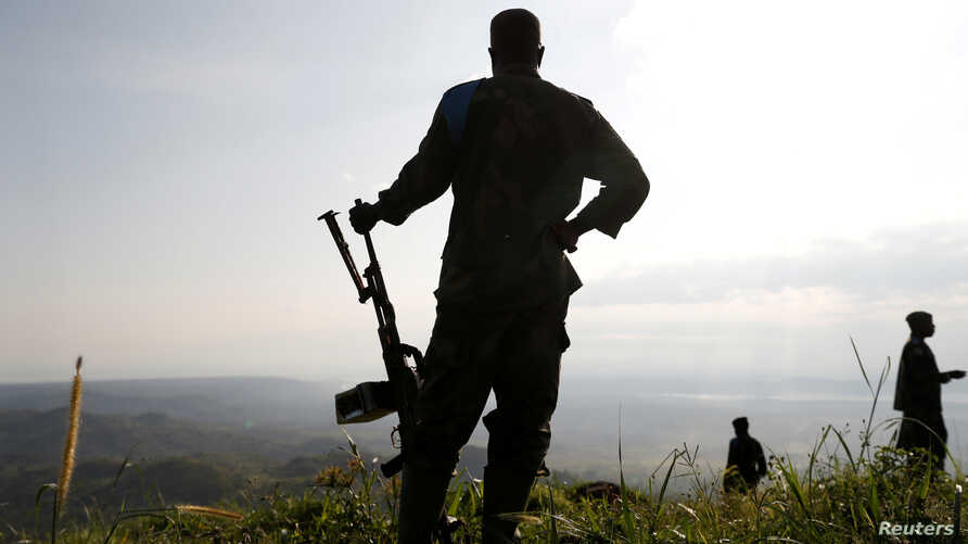 Soldiers stand in an Armed Forces of Democratic Republic of Congo field camp in Paida near Beni, North Kivu Province of Democratic Republic of Congo, Dec. 7, 2018.