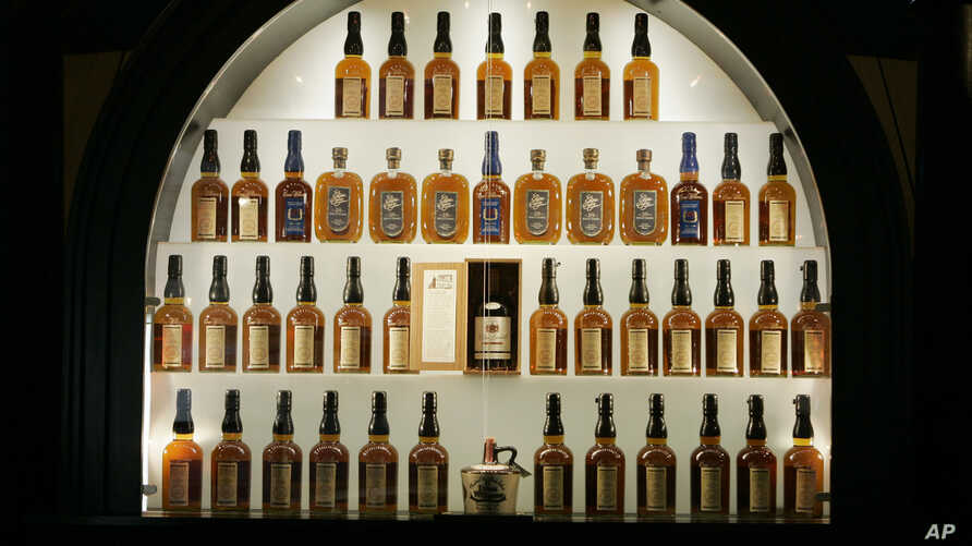 FILE- Bottles of bourbon are shown in a display case at the Heaven Hill Bourbon Heritage Center in Bardstown, Ky., April 8, 2009.