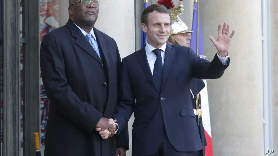 Burkina Faso's President Roch Marc Christian Kabore, left, is welcomed by French President Emmanuel Macron at the Elysee Palace in Paris, France, Dec. 17, 2018.