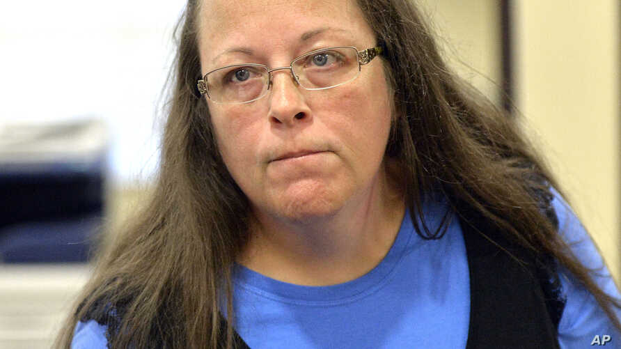 Rowan County Clerk Kim Davis listens to a customer following her office's refusal to issue marriage licenses at the Rowan County Courthouse in Morehead, Ky., Sept. 1, 2015.