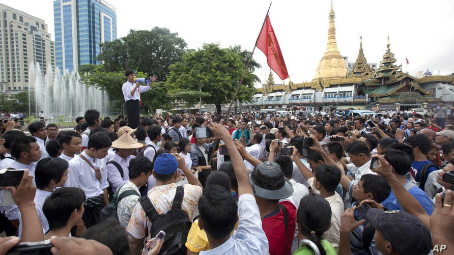 A student activist speaks during a rally protesting constitutional amendments June 30, 2015, in downtown Yangon, Myanmar.