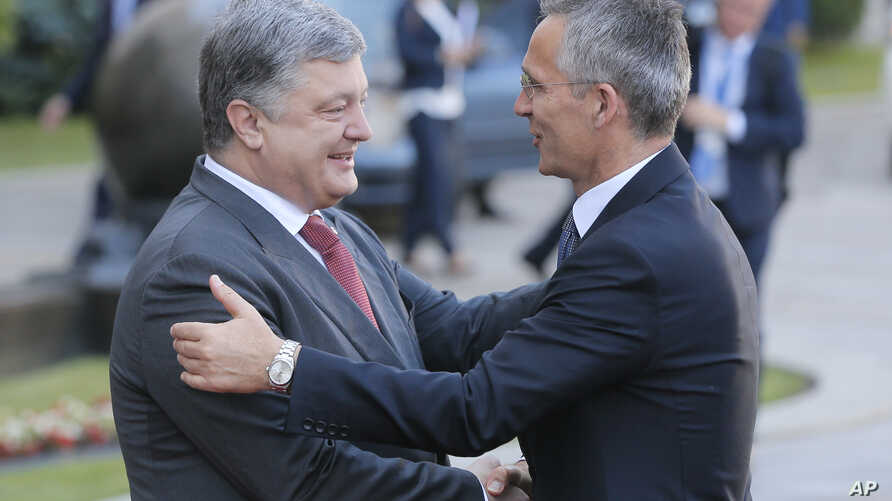 Ukrainian President, Petro Poroshenko, left, and NATO Secretary General Jens Stoltenberg, shakes hands during a meeting in Kiev, Ukraine, July 10, 2017.