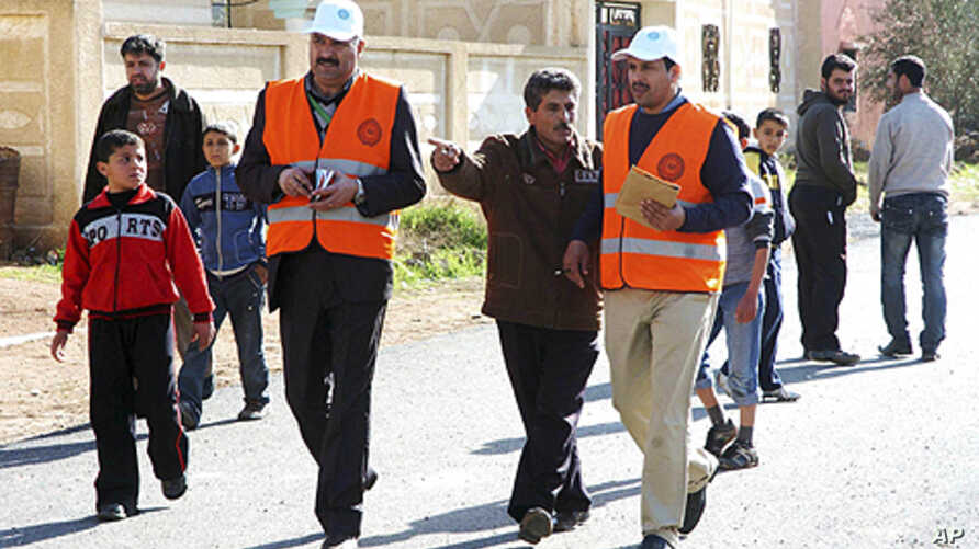 Members from Arab League observers delegation visit al-Msefra town near Deraa, southern Syria, January 5, 2012, in this handout photograph released by Syria's national news agency SANA.