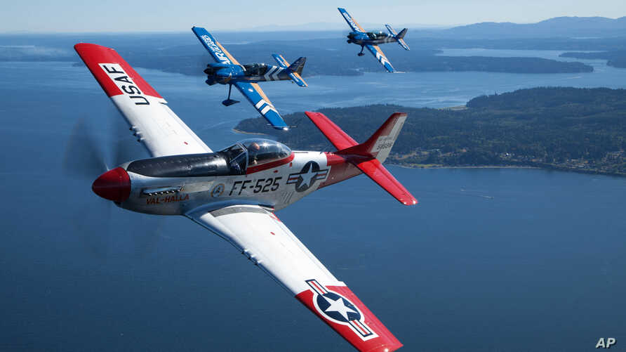 Air National Guard and the Heritage Flight Museum's P-51 Mustang flies over Seattle, Wash., July 30, 2015.