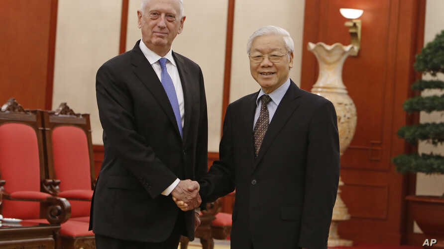 U.S. Secretary of Defense Jim Mattis, left, shakes hands with Vietnam's Communist Party General Secretary Nguyen Phu Trong before holding talks in Hanoi, Vietnam, Jan. 25, 2018.
