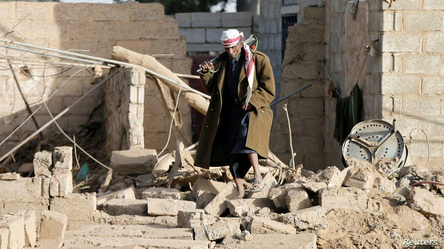 A man walks at the site of a Saudi-led air strike in the Houthi-held capital Sanaa, Yemen, Jan. 20, 2019.