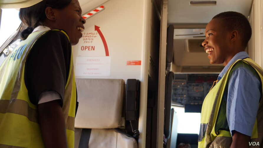 Excitement among crew members was the order of the day during all-female flight preparations at Chileka International Airport in Blantyre, Malawi, March 16, 2017. (L. Masina/VOA)