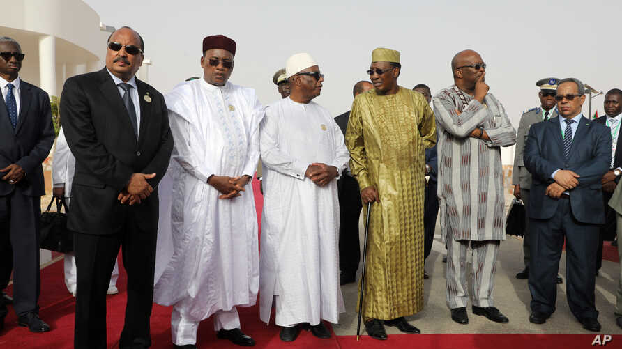 In this pictured taken Monday, July 2, 2018, left to right : Mauritania President Mohamed Ould Abdel Aziz, Niger President Mahamadou Issoufou, Mali President Ibrahim Boubacar Keita, Chad President Idriss Deby, Burkina Faso President Roch Marc Christi