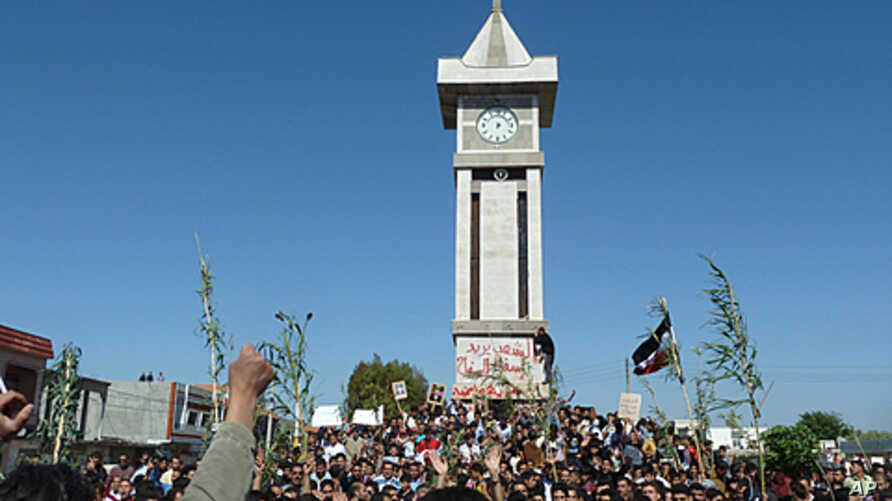 Demonstrators protesting against Syria's President Bashar al-Assad gather in Hula, near Homs in this undated handout released November 4, 2011.