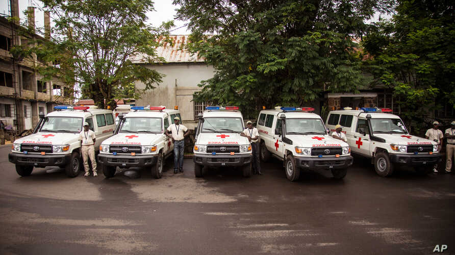 Five ambulances, were donated by the U.S. to help combat the Ebola virus, are lined up following a ceremony attended by Sierra Leone President Ernest Bai Koroma in Freetown, Sierra Leone, Sept. 10, 2014.
