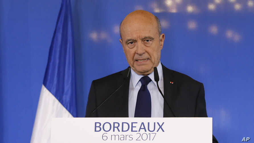 Former French prime minister Alain Juppe delivers his speech in Bordeaux, southwestern France, Monday, March 6, 2017. Juppe has confirmed that he won't be a replacement for the embattled conservative presidential candidate Francois Fillon if he decid