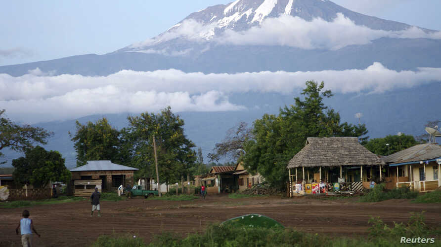 Houses are seen at the foot of Mount Kilimanjaro in Tanzania's Hie district, Dec. 10, 2009.
