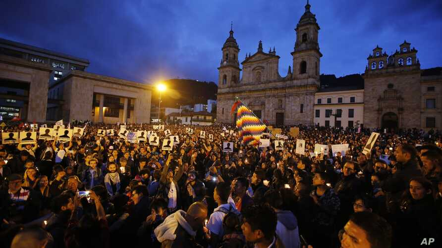 Demonstrators light candles during a vigil for activists who have been killed since the signing of the peace accords in Bogota, Colombia, July 6, 2018. Thousands of people gathered at the Bolivar's square for the vigil.