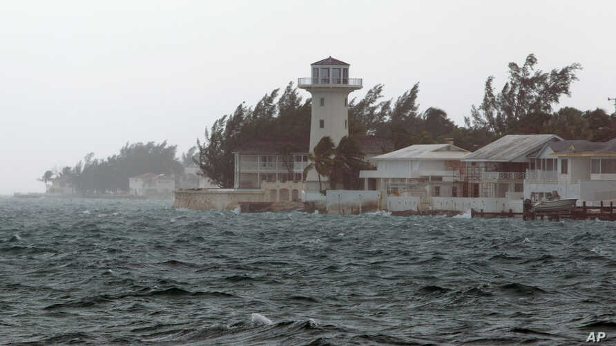 Wind and rain from Hurricane Joaquin affect Nassau, Bahamas, Friday, Oct. 2, 2015. Hurricane Joaquin dumped torrential rains across the eastern and central Bahamas on Friday as a Category 4 storm.