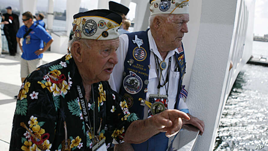 Pearl Harbor survivors George Richard (L) and Charlie Boswell talk about where they were on December 7, 1941 as they tour the Arizona Memorial at the World War II Valor in the Pacific National Monument in Honolulu, Hawaii December 5, 2011.