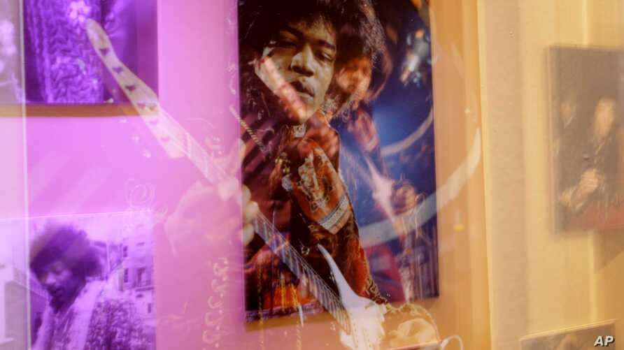 FILE- A photograph on display at an exhibition devoted to U.S. musician Jimi Hendrix, held at the Handel House Museum in central London, Aug. 24, 2010.