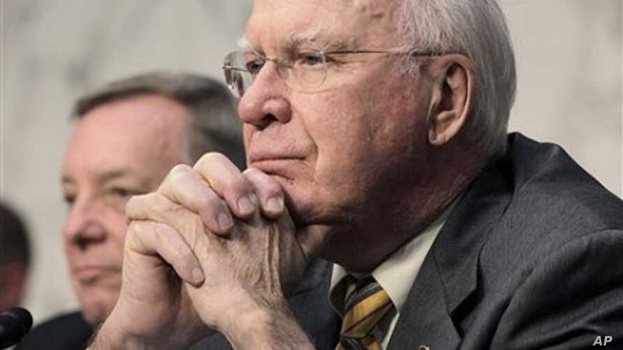 Senate Judiciary Committee Chairman Sen. Patrick Leahy, D-Vt., right, listens to testimony on Capitol Hill in Washington, during the committee's hearing examining the validity of the national health care law under the Constitution, February 02, 2011.