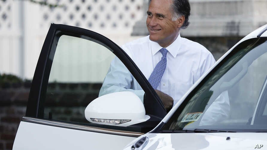 Mitt Romney gets into a vehicle as he leaves after meeting with President-elect Donald Trump at Trump National Golf Club in Bedminster, N.J., Nov. 19, 2016.