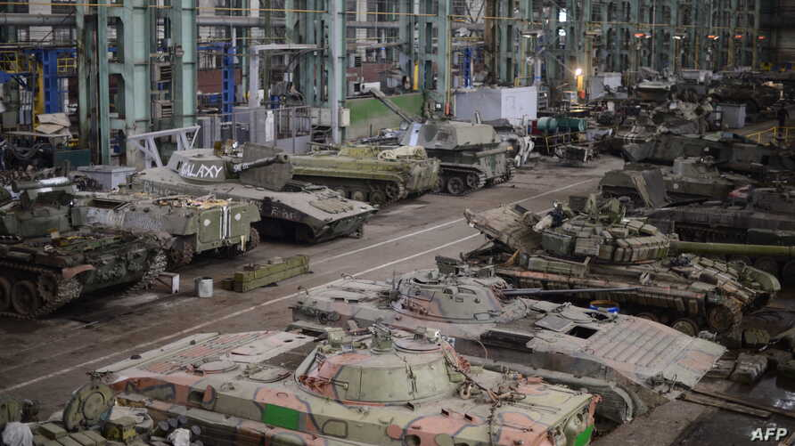A General view taken on March 12, 2015 shows a tank repair workshop in the rebel stronghold of Donetsk.