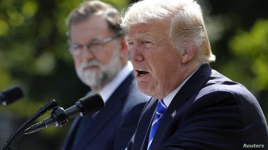 Spanish Prime Minister Mariano Rajoy and U.S. President Donald Trump hold a joint news conference in the Rose Garden at the White House in Washington, Sept. 26, 2017.