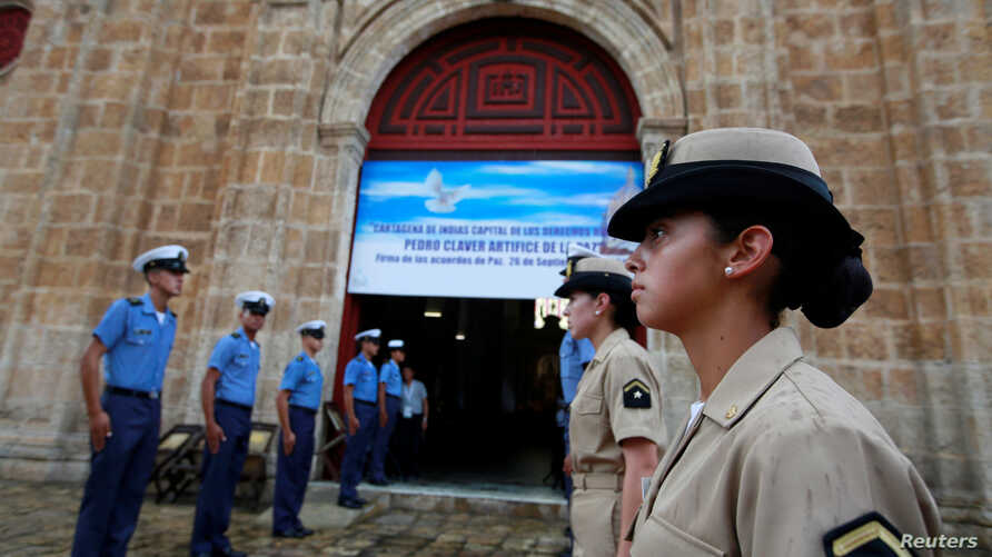 Members of the Colombian navy gather outside a church where President Juan Manuel Santos will attend mass on Monday, before signing a peace agreement with the Revolutionary Armed Forces of Colombia (FARC), in Cartagena, Colombia, September 25, 2016.
