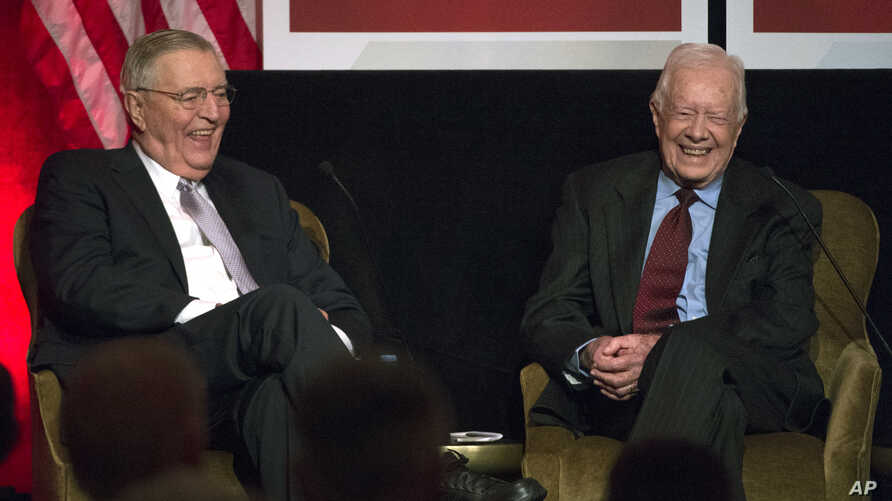 Former President Jimmy Carter participate in a tribute to former Vice President Walter Mondale, left, in Washington, Oct. 20, 2015.