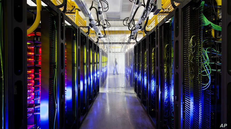 In this undated file photo made available by Google shows the campus-network room at a data center in Council Bluffs, Iowa.