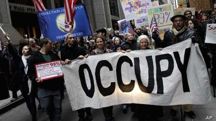 Occupy Wall Street protesters march through lower Manhattan in New York, Thursday, Nov. 17, 2011. Two days after the encampment that sparked the global Occupy protest movement was cleared by authorities, demonstrators marched through New York's finan