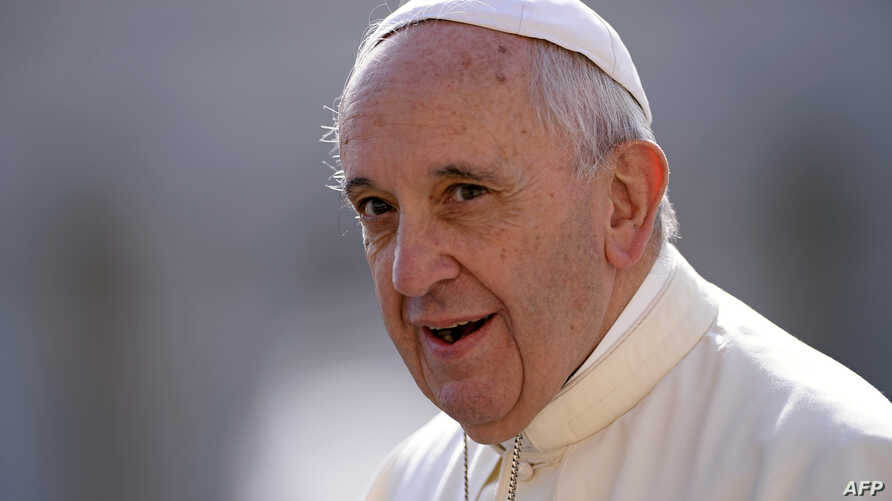 Pope Francis arrives in St Peter's square at the Vatican on Sept. 9, 2015, for his weekly general audience.